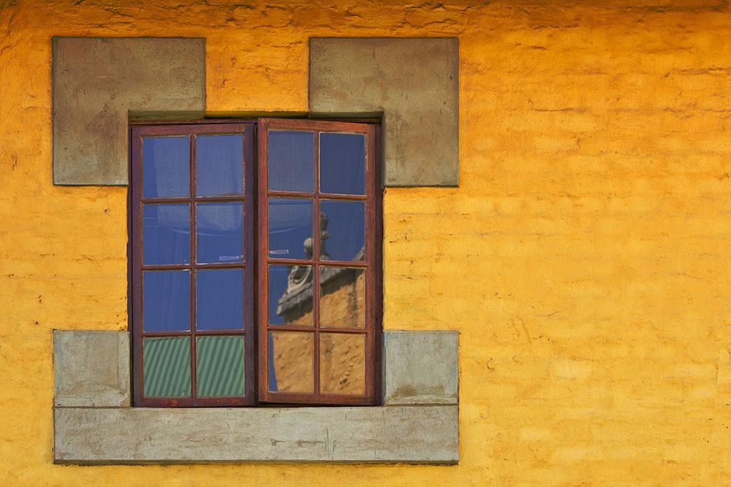Fotografía reflejo en ventana